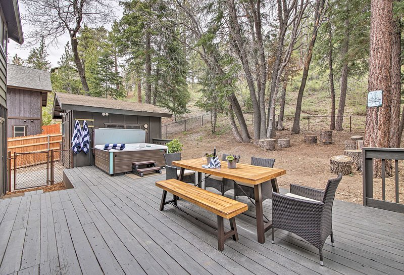 Step outside to breathe in the mountain air, soak in the hot tub, or host a BBQ!