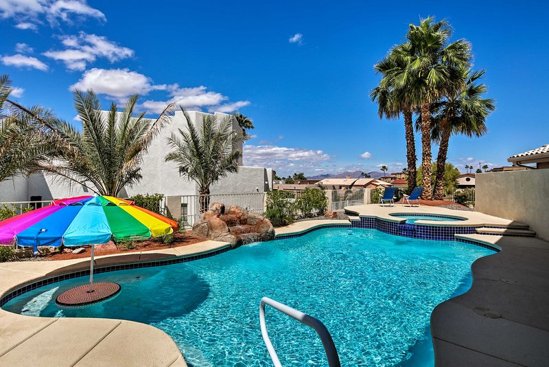 Swim in the turquoise waters of the swimming pool at this vacation rental.