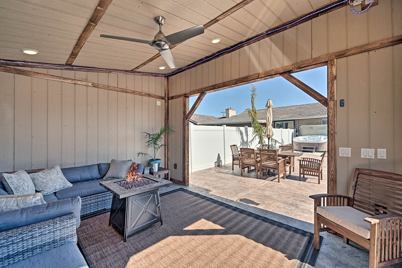 Spend your evenings around the fire pit at this Bluffdale vacation rental home!