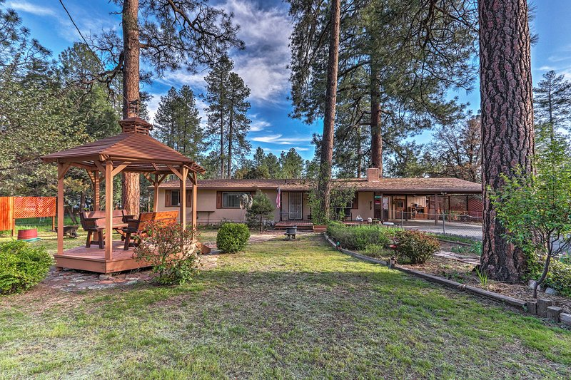 The expansive yard features a gazebo, gardens and more!