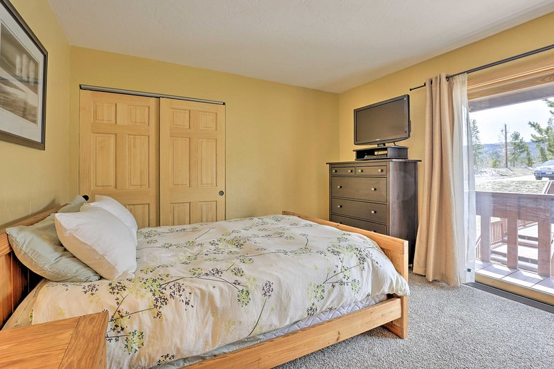 The master bedroom boasts a queen bed, flat-screen TV & direct patio access.