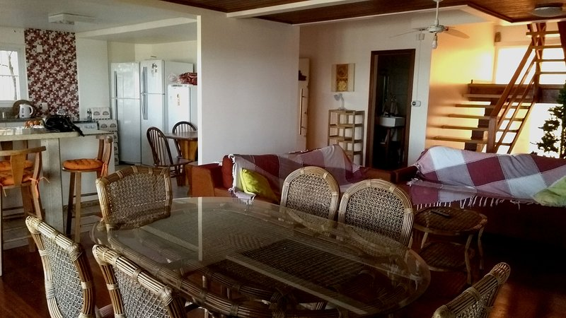 Large living room and kitchen. Kitchen containing 02 refrigerators + 01 vertical freezer.