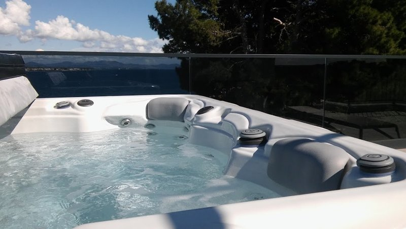 private jacuzzi on roof terrace with sea view and town view
