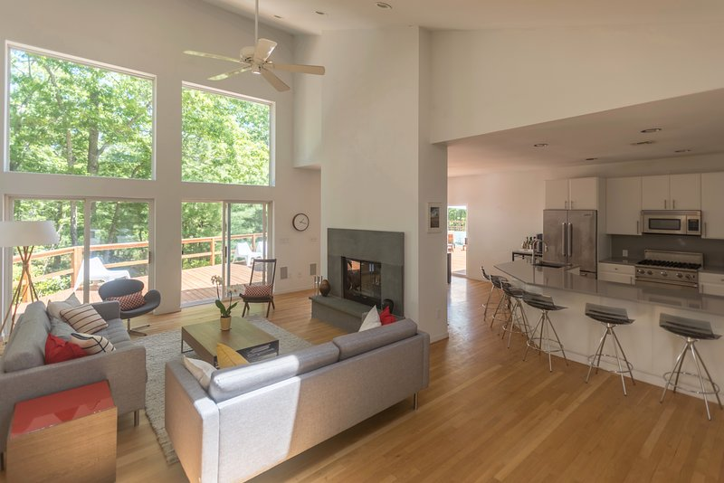 Open living/Dining/Kitchen area with Sonos speakers and hue mood lighting throughout the house