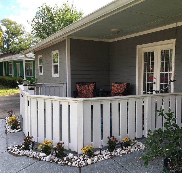 Front entrance of cottage. Love the front porch! Cozy glider rockers, coffee, great book :)