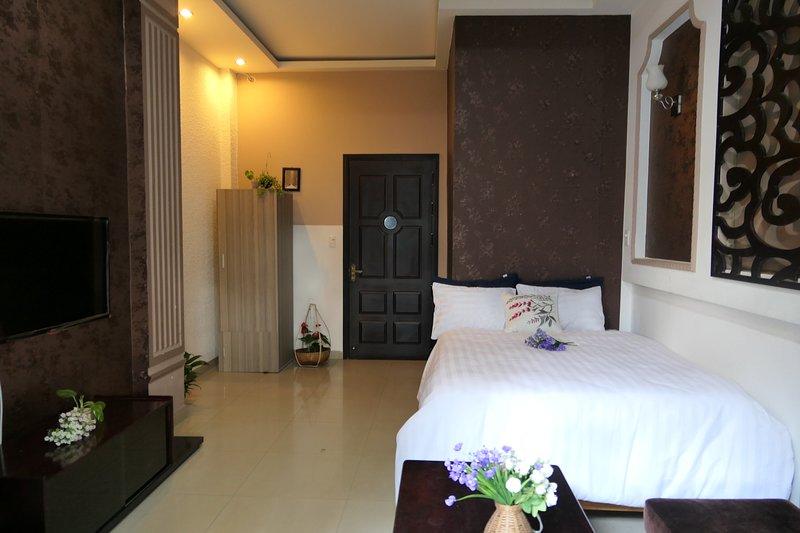 Friendly Homestay - cozy room ,share bathroom with bacolny, casa vacanza a An Hai Tay