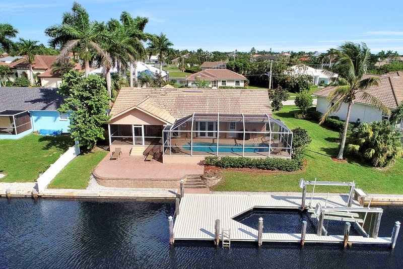 Stunning aerial view of your house from the canal.