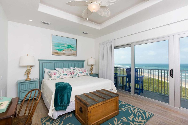 The beautiful master bedroom has an amazing view!
