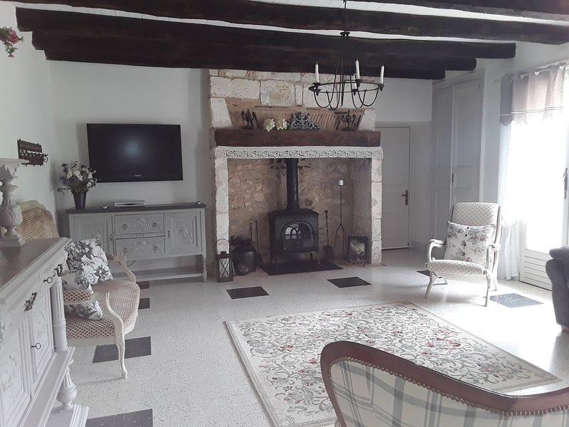 2nd sitting room, with wood burning stove for off season stays. Flat screen TV with English channels