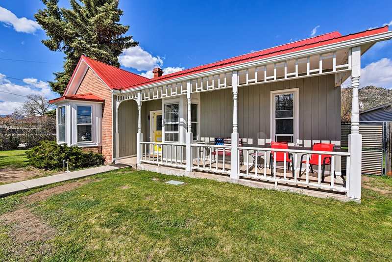 The covered front porch hosts ample seating to accommodate your group.