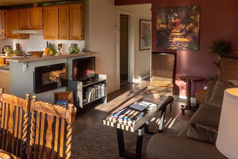 Living/dining showing doorway into first bedroom.