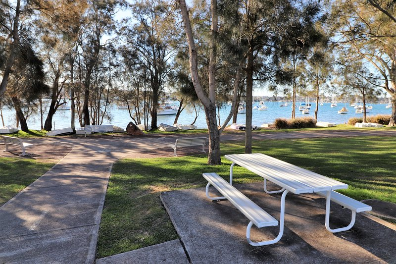 The pathway leads to picnic areas and local shops