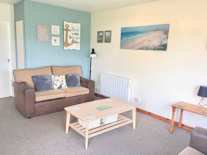 Lovely open plan living space .... lovely fun seaside  decor