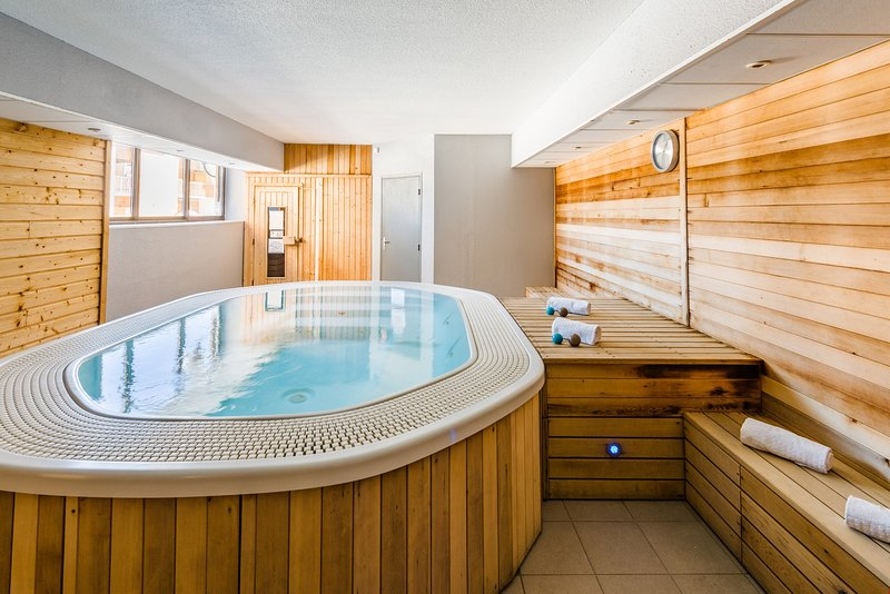 Soak sore muscles in the SHARED indoor hot tub.