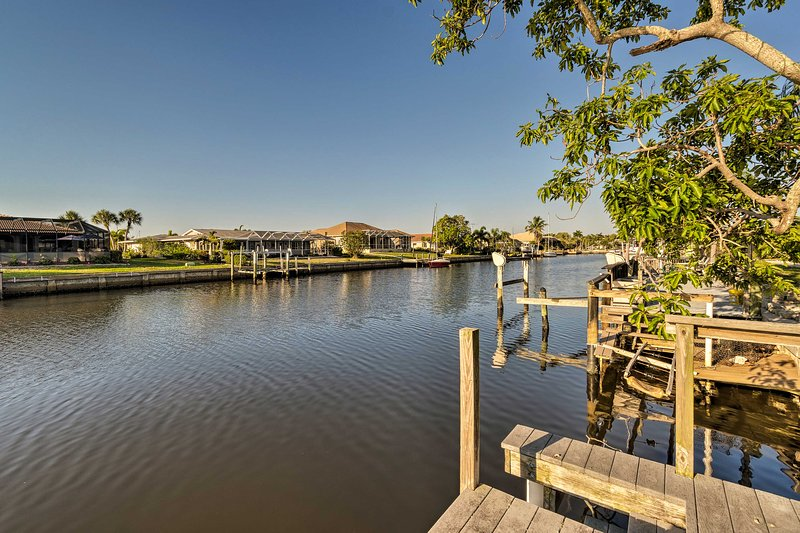 Fish and swim with ease from the dock steps from the vacation rental.