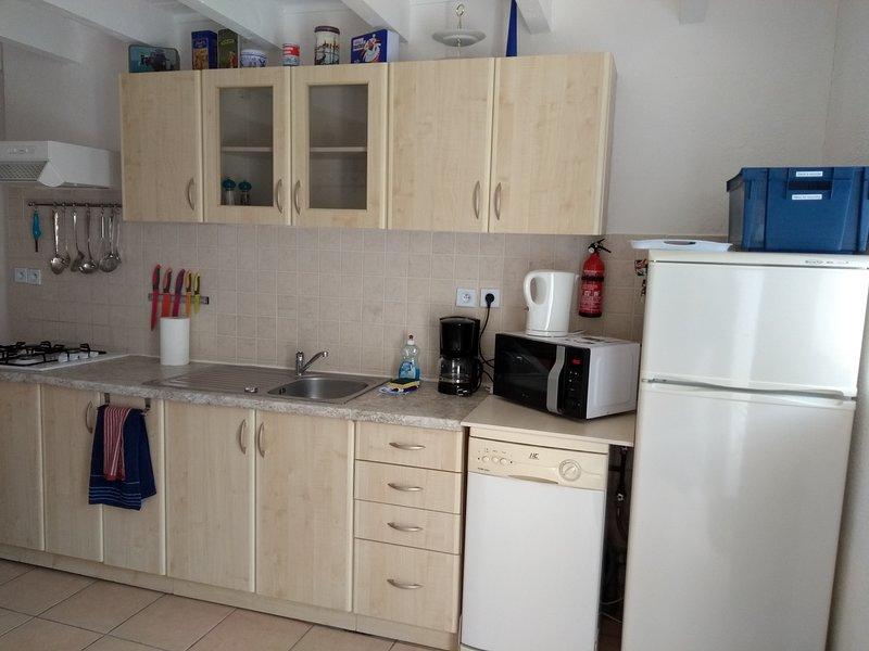 Kitchen with fridge and dishwasher