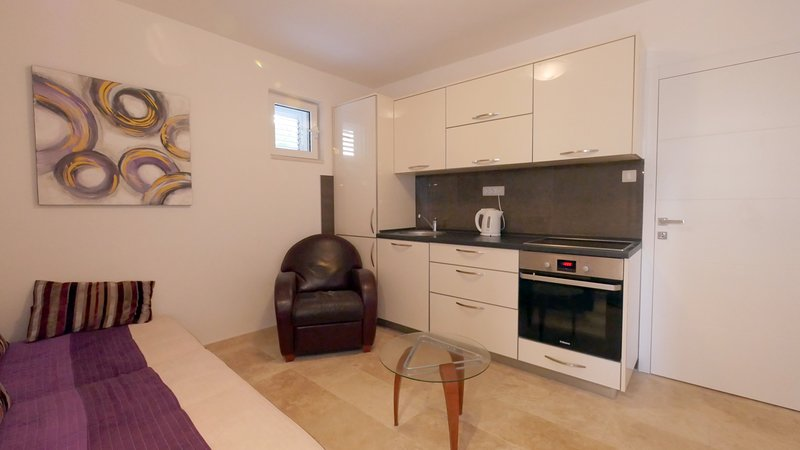 Fully fitted kitchen with hob, freezer, fridge and oven