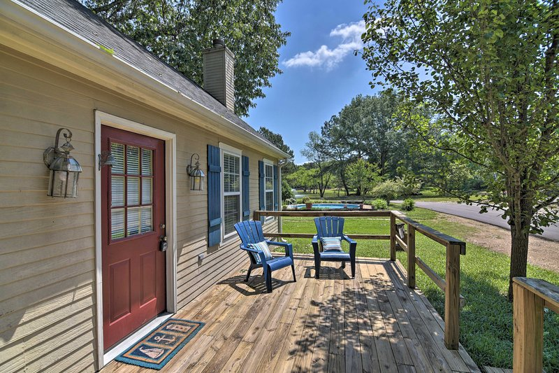 This property boasts a charming front porch, shared, pool, ponds, and more!
