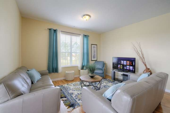 Newly Remodeled Living Area; Comfortable Leather Seating, Side Chair and Flat Screen TV