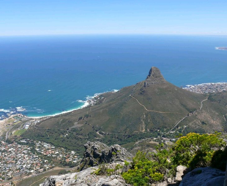 A breathtaking cable car trip up Table Mountain in Cape Town, overlooking Lion's Head facing West.