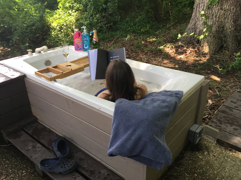 Take a bubble bath in our outdoor jacuzzi! in the woods