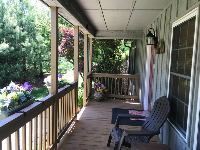 Front porch with 2 Adirondack chairs