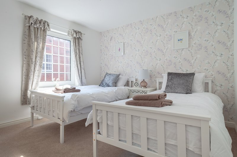 light, airy, twin bed room