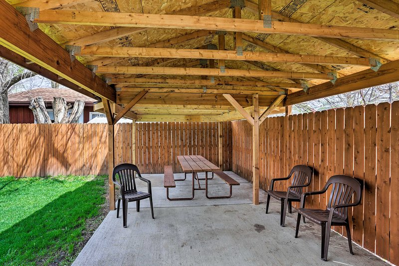 This vacation rental offers 2 bedrooms, 1 bath, and a covered patio!
