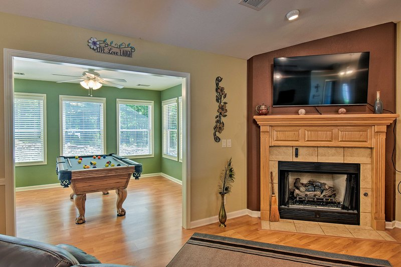 You'll be treated to great amenities like a gas fireplace and pool table.