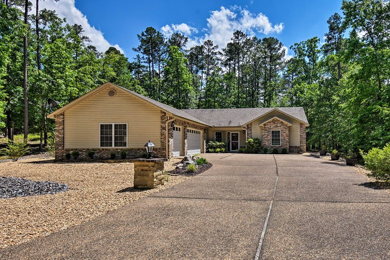 Plan your next retreat to this Hot Springs Village vacation rental house.