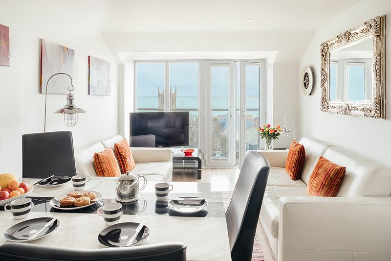 Living room and dining area with far reaching sea views.