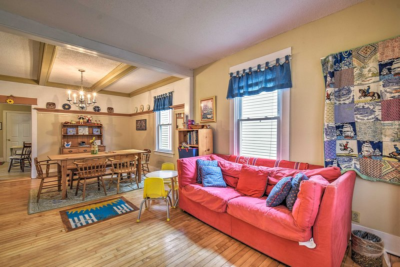 The colorful cottage features 2 bedrooms and 1 bathroom for 4 guests.