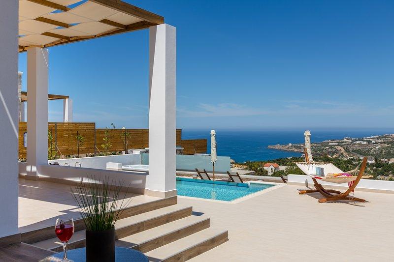 Myrtia Villa, coastal vistas, aluguéis de temporada em Kato Valsamonero