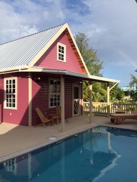 Low Caye Cottages - Purple Pearl Cottage, aluguéis de temporada em Caye Caulker