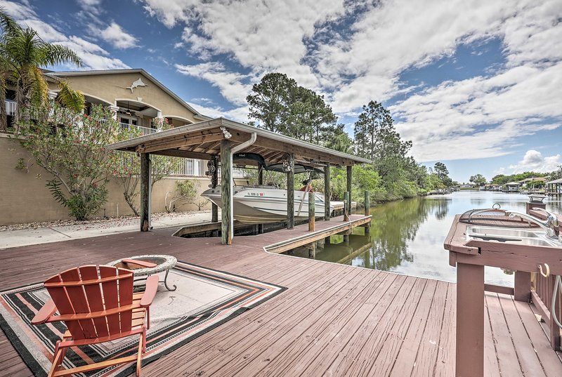 This beautiful residence sits on a corner lot and has a dock on the canal!