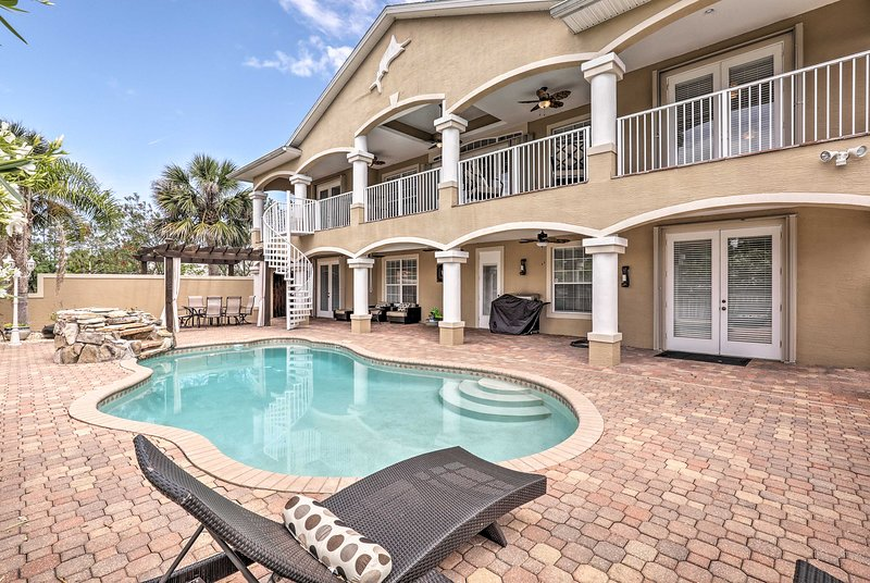 Escape to this luxurious 5-bedroom, 4-bathroom manor in Palm Coast!
