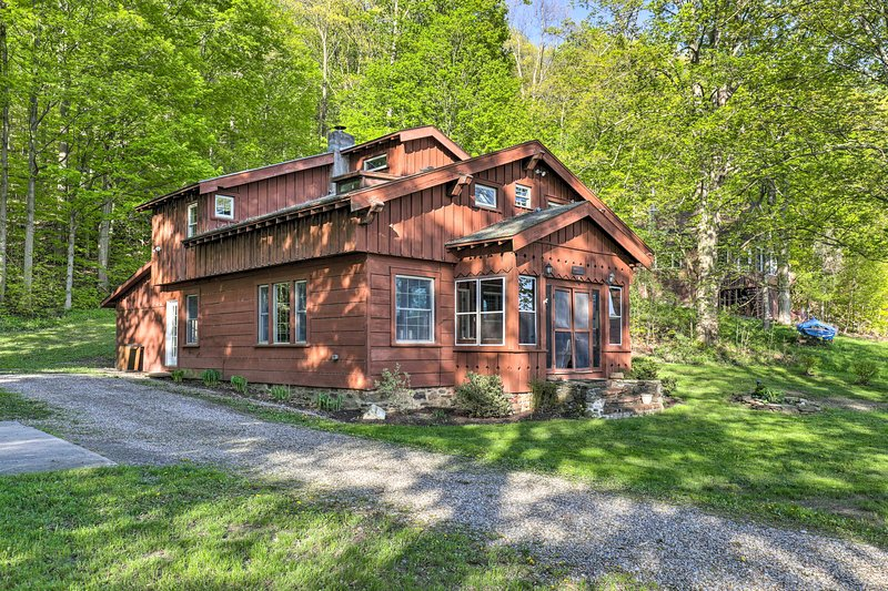 The 3-bedroom, 2-bathroom vacation rental is set among the woods.