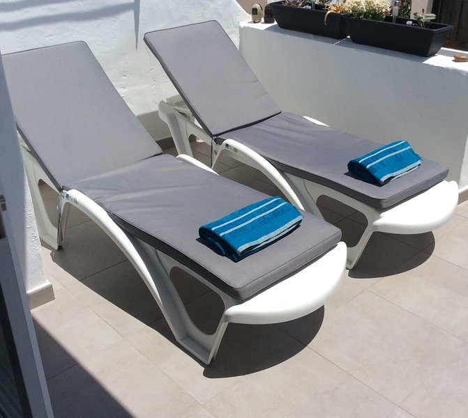 Sunny terrace with loungers