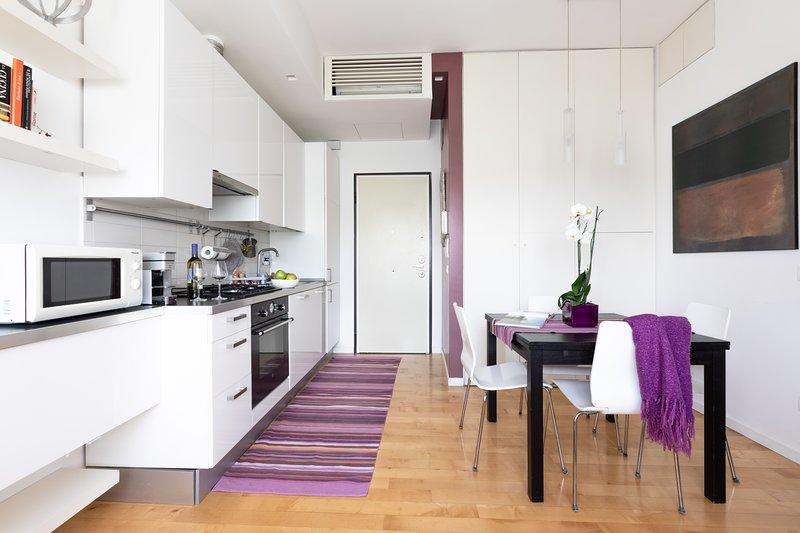 Área de cocina y mesa