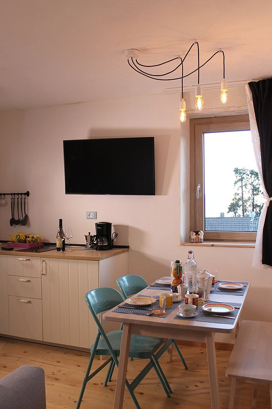 The dining room with fully equipped kitchen.