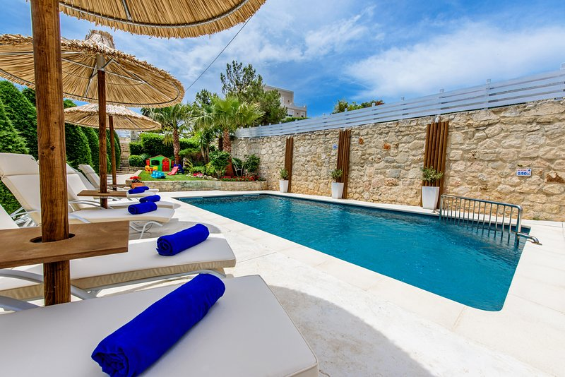 Wonderful sunbathing terrace equipped with sun beds and umbrellas!