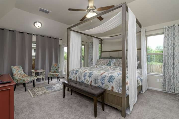 Beautiful master bedroom with sitting area - the perfect spot to retreat after a long day