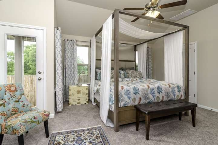 Master bedroom with memory-foam King bed and private access to backyard.