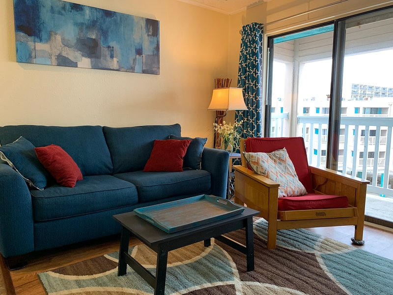 The living room features a full-size sofa sleeper.