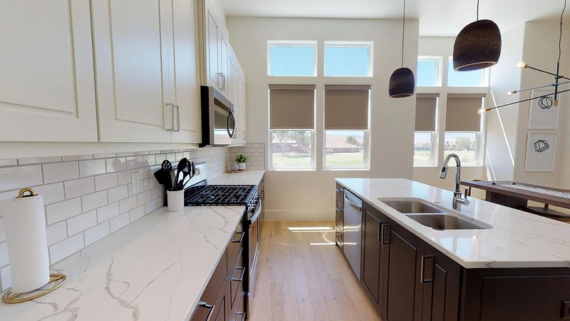 Fully stocked gourmet kitchen featuring granite countertops
