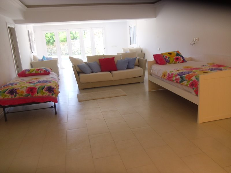 Single beds with bathroom and direct access to the pool.