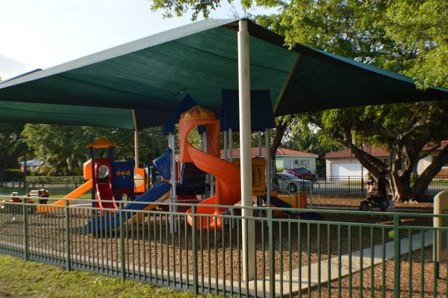 Biscayne Park offers a playground, volleyball court and racket ball court all within a 3 minute walk from the home!