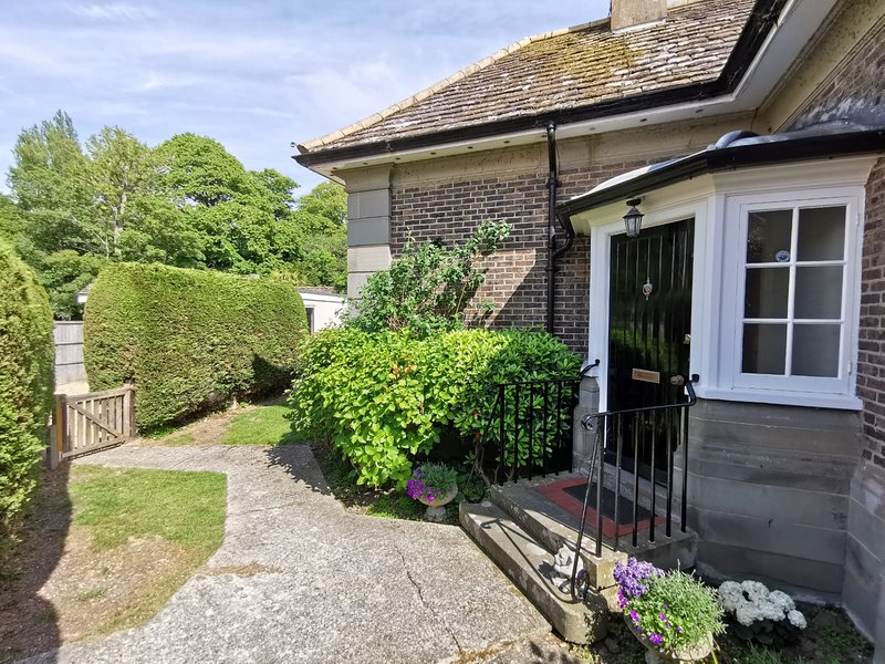 A beautifully renovated gatehouse which is a four minute walk from the beach