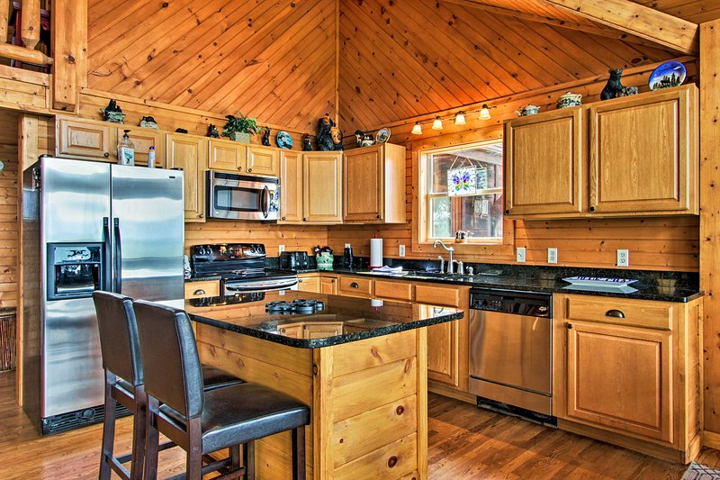 The cabin boasts 3 bedrooms, 3 baths, and accommodations for up to 8 guests.