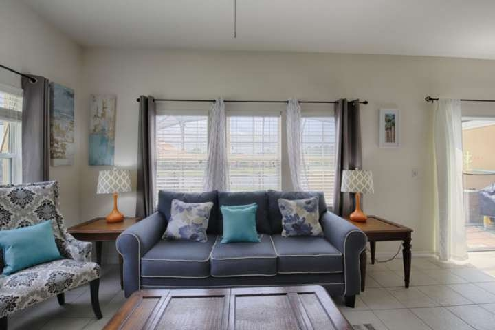 Newly Remodeled Living Room Features Comfortable Furniture, Flat Screen TV and Pool Access